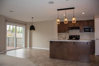 Photo 9: 14 HILLCREST Street SW: Airdrie Detached for sale : MLS®# A1031272