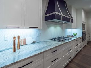 Photo 8: 4 Rosetree Crescent NW in Calgary: Rosemont Detached for sale : MLS®# A1084725