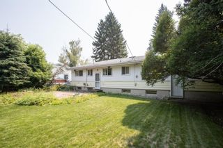 Photo 1: 2328 58 Avenue SW in Calgary: North Glenmore Park Detached for sale : MLS®# A1130448