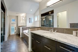 Photo 19: 127 Springbluff Boulevard SW in Calgary: Springbank Hill Detached for sale : MLS®# A1140601