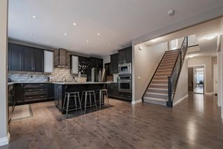 Photo 6: 28 ROCKFORD Terrace NW in Calgary: Rocky Ridge Detached for sale : MLS®# A1069939