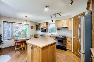 Photo 13: 14 Sienna Park Terrace SW in Calgary: Signal Hill Detached for sale : MLS®# A1142686
