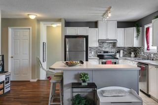 Photo 17: 1905 7171 COACH HILL Road SW in Calgary: Coach Hill Row/Townhouse for sale : MLS®# A1111553