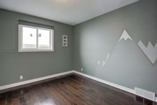Photo 34: 140 Stratton Crescent SW in Calgary: Strathcona Park Detached for sale : MLS®# A1072152
