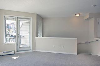 Photo 4: 128 Mckenzie Towne Lane SE in Calgary: McKenzie Towne Row/Townhouse for sale : MLS®# A1106619
