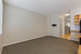 Photo 13: 94 Everridge Gardens SW in Calgary: Evergreen Row/Townhouse for sale : MLS®# A1069502