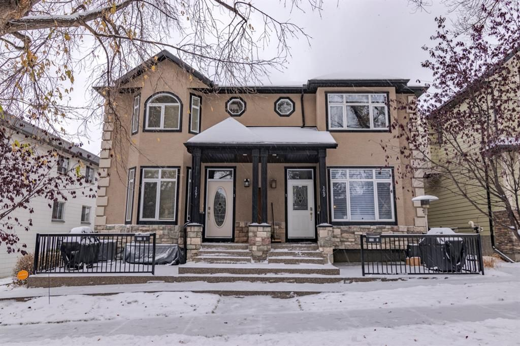 Main Photo: 2 127 27 Avenue NW in Calgary: Tuxedo Park Row/Townhouse for sale : MLS®# A1044558