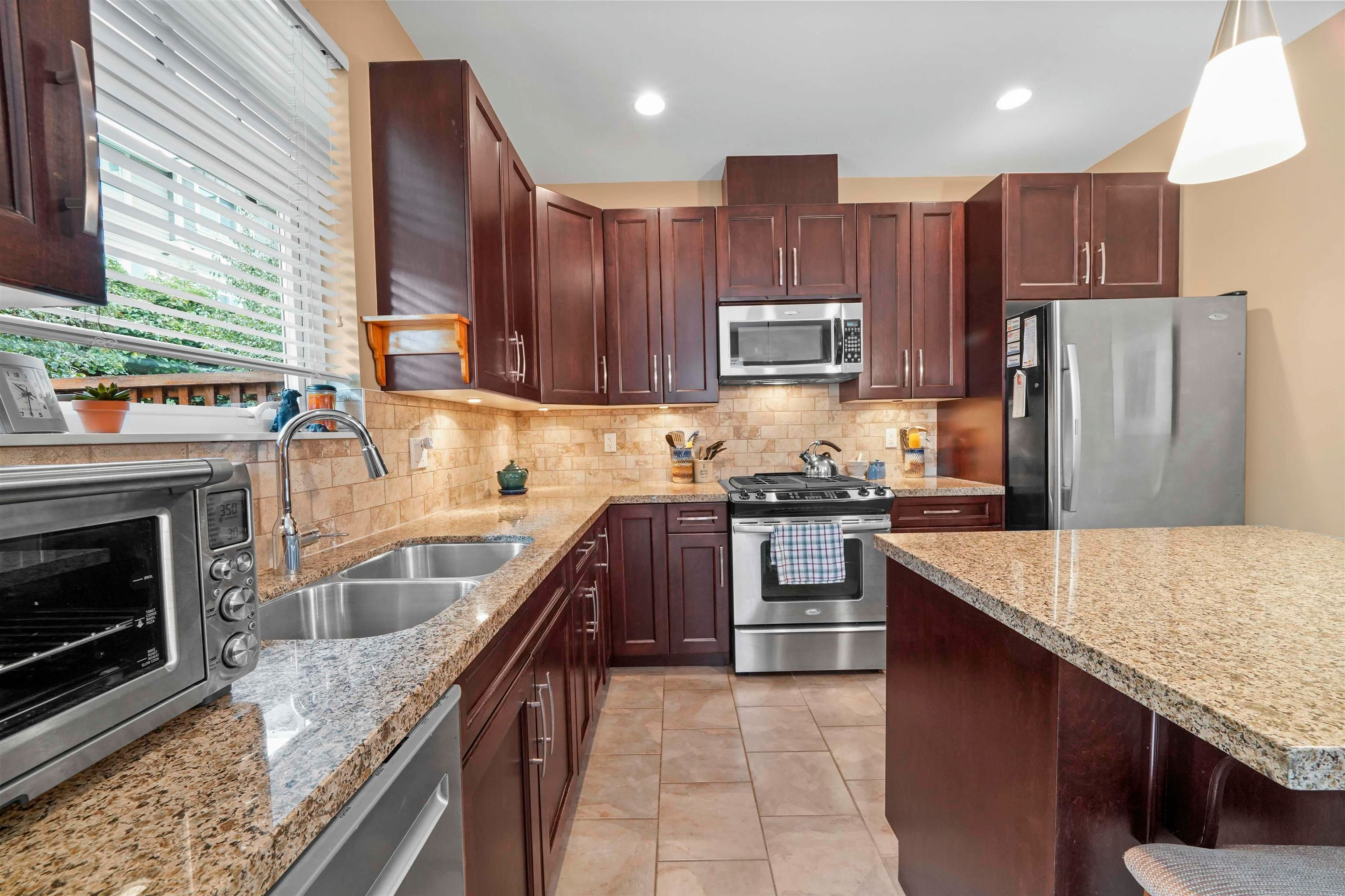 """Main Photo: 8 2979 156 Street in Surrey: Grandview Surrey Townhouse for sale in """"ENCLAVE"""" (South Surrey White Rock)  : MLS®# R2623582"""
