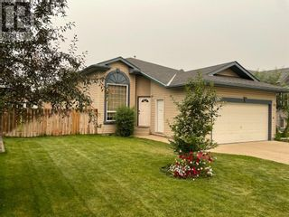 Photo 2: 1207 3 Street W in Brooks: House for sale : MLS®# A1138121