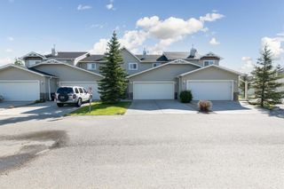 Photo 2: 58 Arbours Circle NW: Langdon Row/Townhouse for sale : MLS®# A1137898