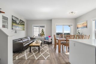 Photo 2: 1404 Jumping Pound Common: Cochrane Row/Townhouse for sale : MLS®# A1146897