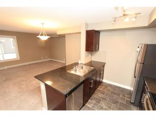 Photo 12: 9104 403 Mackenzie Way SW: Airdrie Apartment for sale : MLS®# A1122241