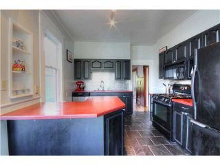 Photo 7: 1147 SEMLIN DR in Vancouver: Grandview VE House for sale (Vancouver East)  : MLS®# V1056763