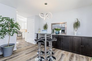 Photo 5: 516 Queen Charlotte Drive SE in Calgary: Queensland Detached for sale : MLS®# A1098339