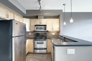 Photo 10: 4 145 Rockyledge View NW in Calgary: Rocky Ridge Apartment for sale : MLS®# A1041175