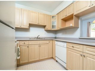 """Photo 2: 805 9274 122ND Street in Surrey: Queen Mary Park Surrey Townhouse for sale in """"WHISPERING CEDARS"""" : MLS®# F1425476"""