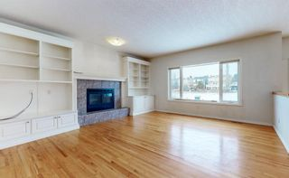 Photo 9: 48 Moreuil Court SW in Calgary: Garrison Woods Detached for sale : MLS®# A1075333