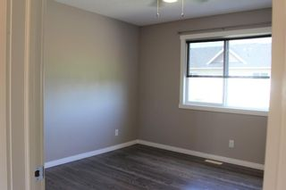 Photo 25: 1404 Clover Link: Carstairs Row/Townhouse for sale : MLS®# A1073804