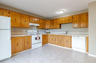 Photo 4: 6408 RANCHVIEW Drive NW in Calgary: Ranchlands Row/Townhouse for sale : MLS®# A1107024