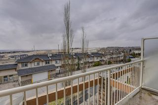 Photo 17: 7 124 Rockyledge View NW in Calgary: Rocky Ridge Row/Townhouse for sale : MLS®# A1111501