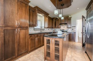 Photo 17: 6868 CLEVEDON Drive in Surrey: West Newton House for sale : MLS®# R2490841
