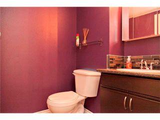 Photo 11: 94 123 QUEENSLAND Drive SE in Calgary: Queensland House for sale : MLS®# C4027673