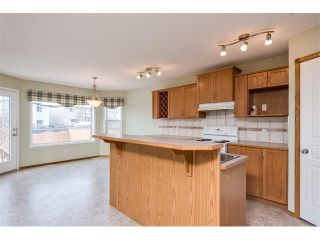 Photo 6: 223 CRYSTALRIDGE Place: Okotoks House for sale : MLS®# C4091900
