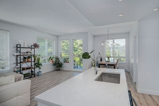 """Photo 1: 313 2382 ATKINS Avenue in Port Coquitlam: Central Pt Coquitlam Condo for sale in """"Parc East"""" : MLS®# R2604837"""