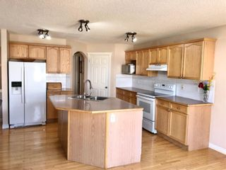 Photo 11: 403 Cresthaven Place SW in Calgary: Crestmont Detached for sale : MLS®# A1132554