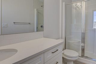 Photo 19: 132 Creekside Drive SW in Calgary: C-168 Semi Detached for sale : MLS®# A1098272