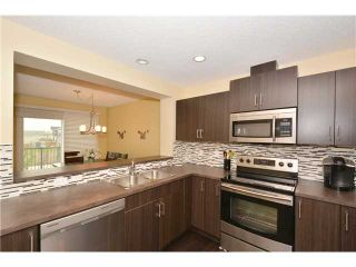 Photo 5: 149 SUNSET Common: Cochrane Residential Attached for sale : MLS®# C3631506