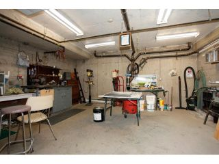 "Photo 18: 311 5955 177B Street in Surrey: Cloverdale BC Condo for sale in ""WINDSOR PLACE"" (Cloverdale)  : MLS®# F1433073"