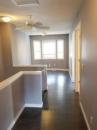 Photo 7: 7 Patina Point SW in Calgary: Patterson Row/Townhouse for sale : MLS®# A1085180
