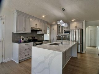 Photo 5: 12 Sienna Heights Way SW in Calgary: Signal Hill Detached for sale : MLS®# A1099178