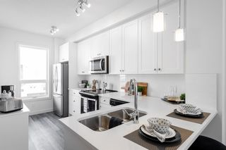 Photo 2: 25 Evanscrest Park NW in Calgary: Evanston Row/Townhouse for sale : MLS®# A1067562
