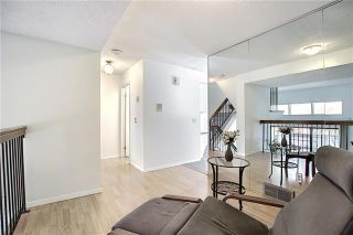 Photo 12: 24 GLAMIS Gardens SW in Calgary: Glamorgan Row/Townhouse for sale : MLS®# A1077235