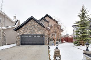 Photo 1: 131 Cougar Plateau Circle SW in Calgary: 2 Storey for sale : MLS®# C3614218