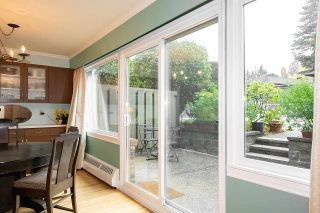 """Photo 1: 104 235 KEITH Road in West Vancouver: Cedardale Townhouse for sale in """"SPURAWAY GARDENS"""" : MLS®# R2518546"""
