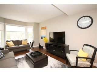 Photo 4: 156 GLENEAGLES Close: Cochrane House for sale : MLS®# C4018066