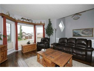 Photo 3: 224 SUNTERRA RIDGE Place: Cochrane Residential Detached Single Family for sale : MLS®# C3633482