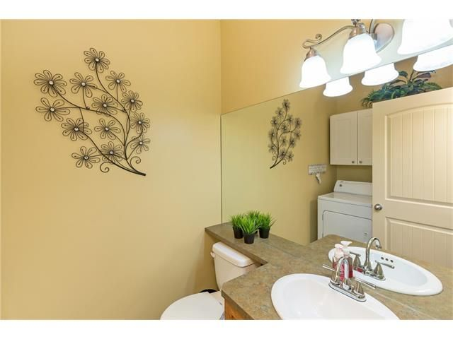 Photo 17: Photos: 664 LUXSTONE Landing SW: Airdrie House for sale : MLS®# C4106944