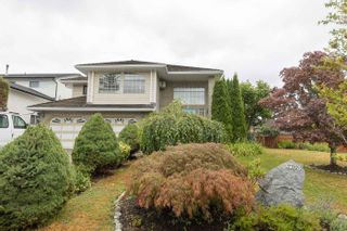Photo 1: 8738 143A Street in Surrey: Bear Creek Green Timbers House for sale : MLS®# R2606825