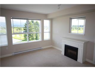 "Photo 2: 426 19673 MEADOW GARDENS Way in Pitt Meadows: North Meadows Condo for sale in ""THE FAIRWAYS"" : MLS®# V952865"