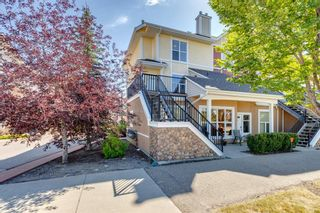 Photo 1: 740 73 Street SW in Calgary: West Springs Row/Townhouse for sale : MLS®# A1138504