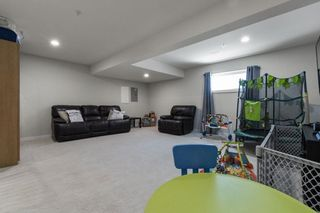 """Photo 26: 21083 79A Avenue in Langley: Willoughby Heights Condo for sale in """"KINGSBURY AT YORKSON"""" : MLS®# R2609157"""