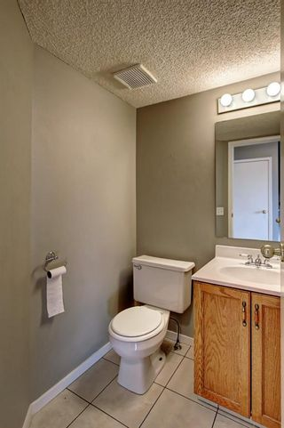 Photo 9: 129 Sandpiper Lane NW in Calgary: Sandstone Valley Row/Townhouse for sale : MLS®# A1106631