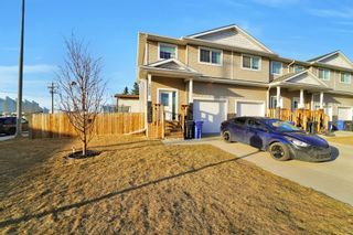 Main Photo: 1002 Minto Street: Penhold Row/Townhouse for sale : MLS®# A1155986