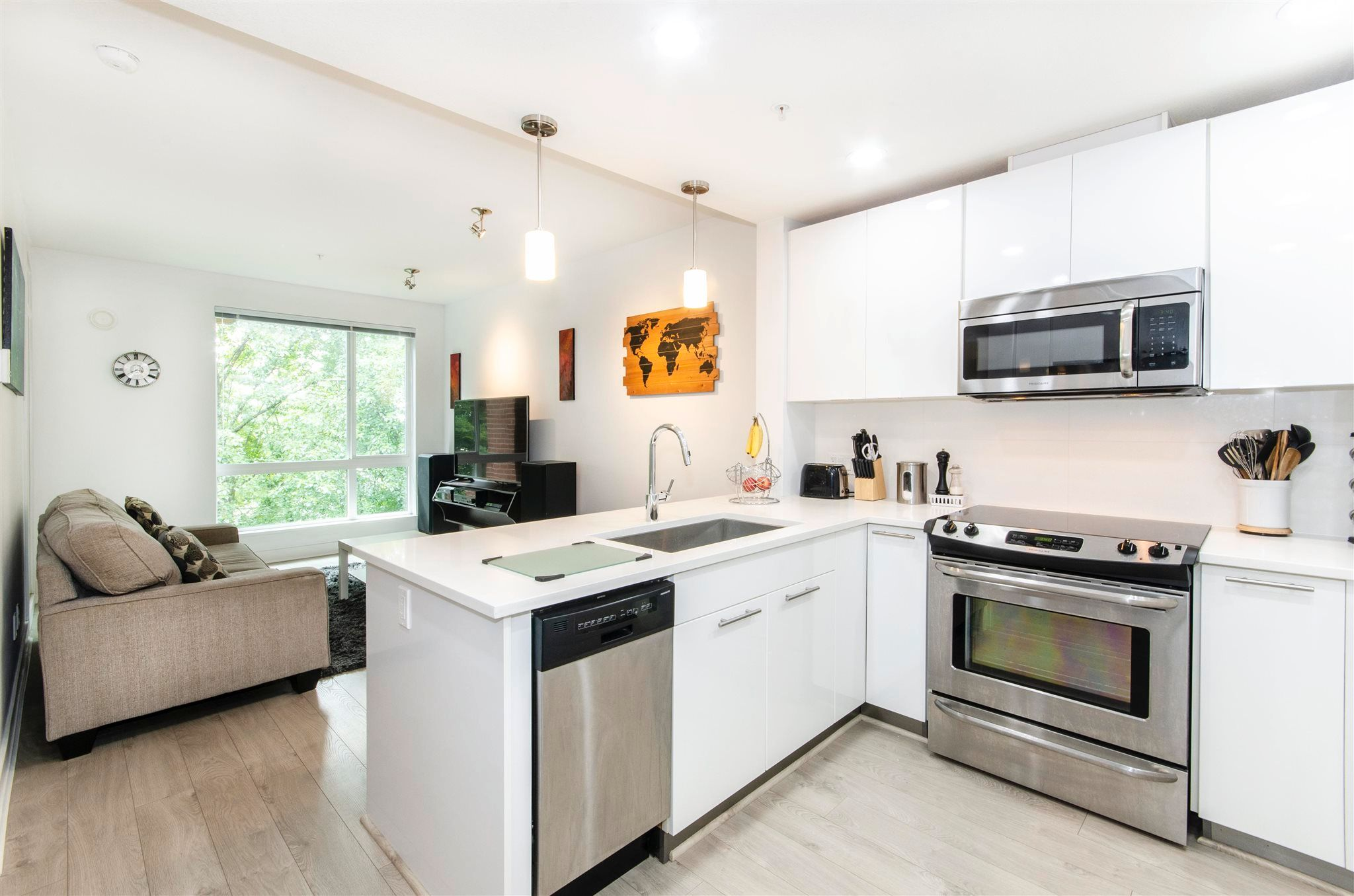"""Main Photo: 404 733 W 3RD Street in North Vancouver: Harbourside Condo for sale in """"The Shore"""" : MLS®# R2603581"""
