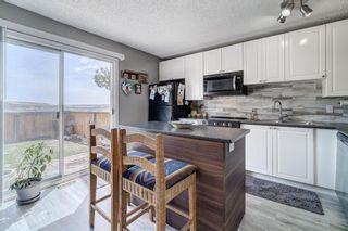 Photo 9: 32 800 Bowcroft Place: Cochrane Row/Townhouse for sale : MLS®# A1106385