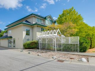 Photo 1: 209 19953 55A Avenue in Langley: Langley City Condo for sale : MLS®# R2603650